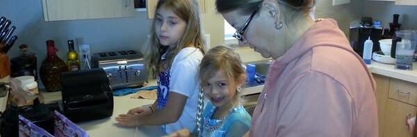 The girls making pretzels with their EasyBake oven…