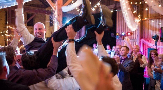Hoist the Groom at the Wedding of the Year